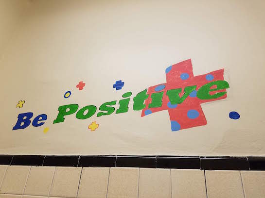 Photo of painted mural stating Be Positive