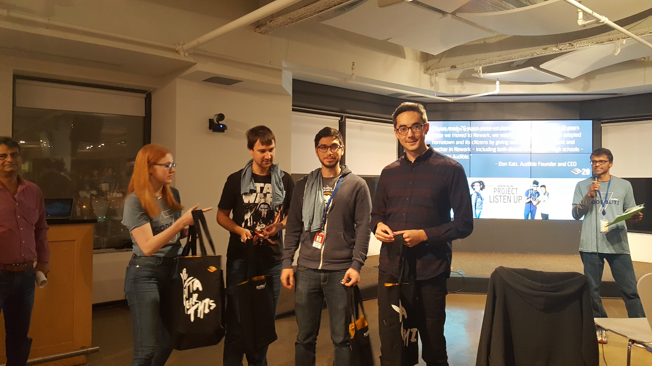 Audible employees presenting their hackathon idea