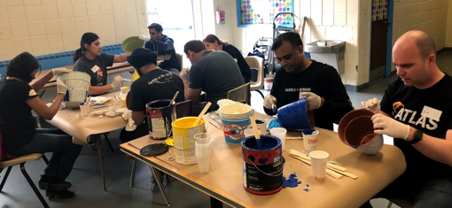 Audible employees painting planters and pots