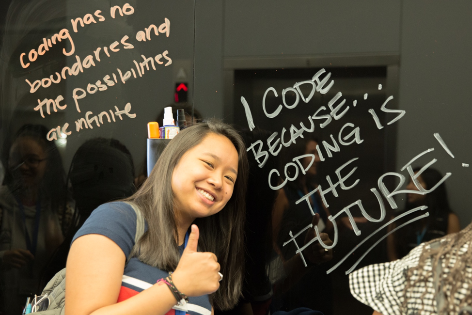 Photo of students from Girls Who Code writing on the whiteboard I code because coding is the future